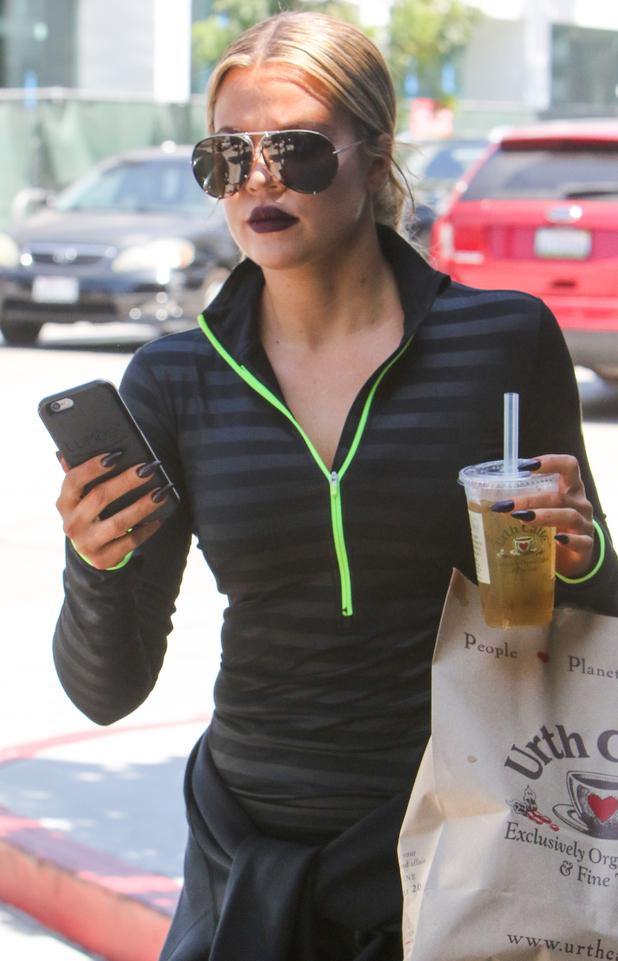 Khloe Kardashian rocking vampy brown lip at the gym in Los Angeles 25th August 2015