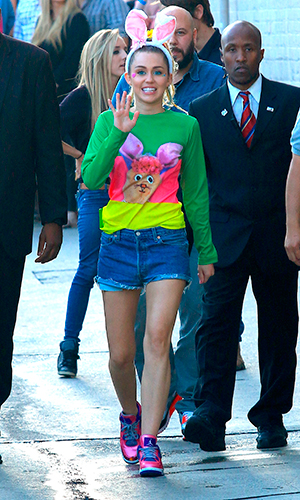 Miley Cyrus seen leaving ABC studios after Jimmy Kimmel Live wearing bright colours and bunny ears 26 August 2015