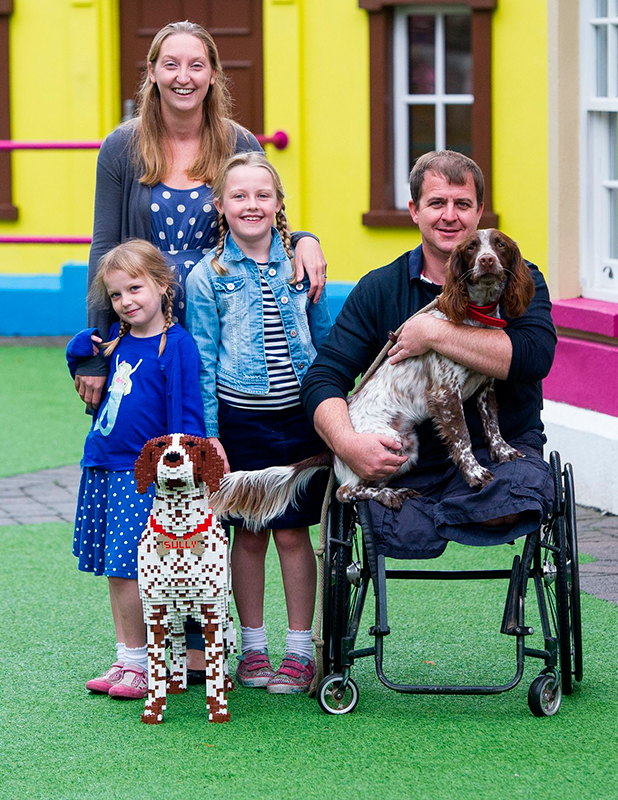 The Harvey family (L-R) Millie (age 6), mum Kerry, Ella (age 8) and dad Gavin with Sully and his Lego double 27 Aug 2015
