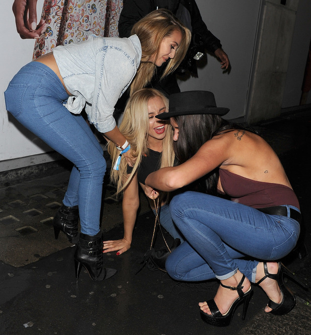 Marnie Simpson, Chloe Goodman, Melissa Reeves take a tumble outside Chinawhite nightclub in London, 3rd September 2015