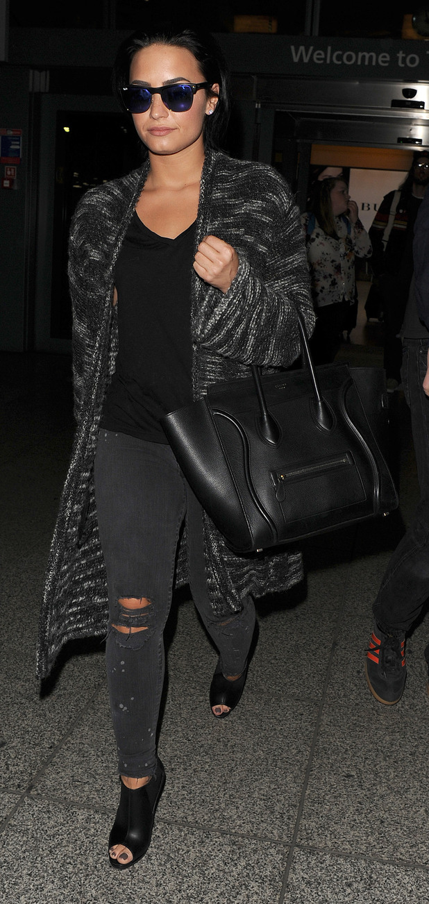 Demi Lovato arriving at Heathrow Airport, 8th September 2015