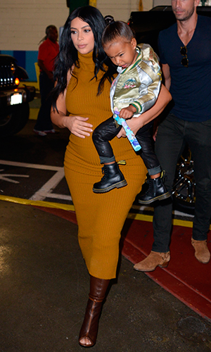 Kim Kardashian and North West are seen on September 9, 2015 in New York City.
