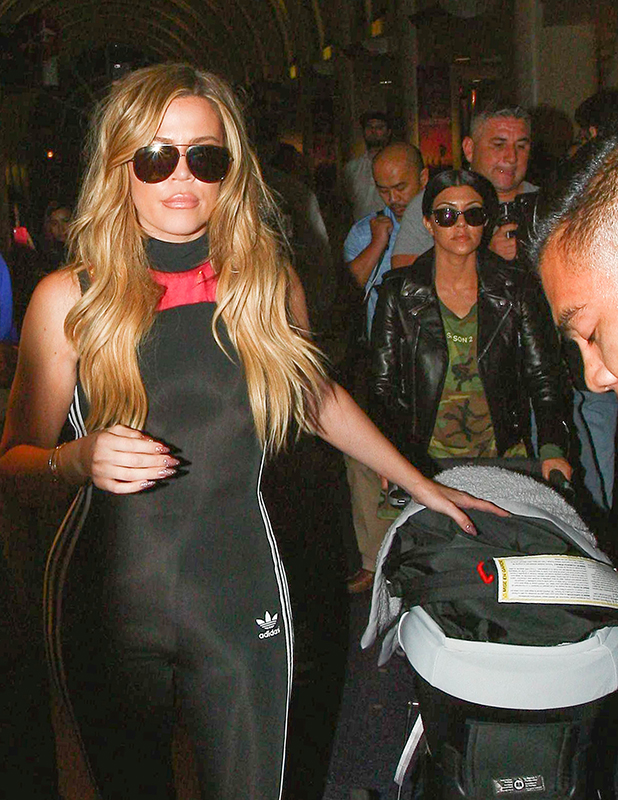 Khloe Kardashian and Kourtney Kardashian are seen at LAX. on September 16, 2015 in Los Angeles, California.