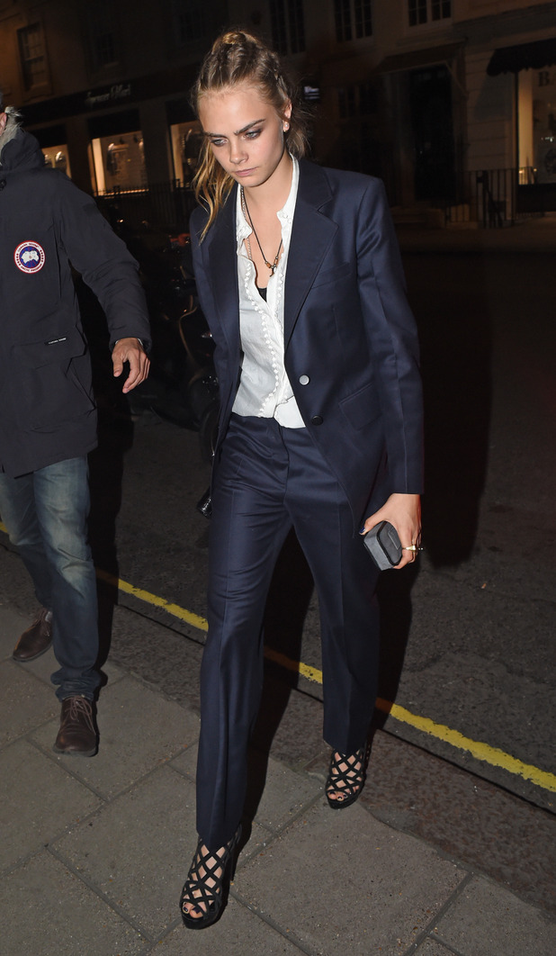 Cara Delevingne seen hanging out in London at The Louis Vuitton Fashion show and afterparty held at Loulou's private members club. 21st September 2015