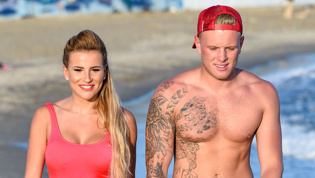 Georgia Kousoulou and Tommy Mallet play around on the beach filming TOWIE Marbs - 24 September 2015.