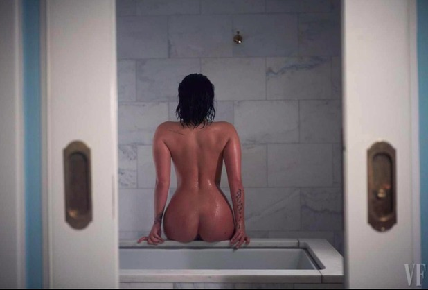 Demi Lovato poses nude for Vanity Fair, October 2015.