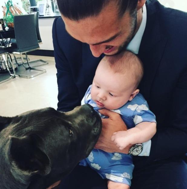 Andy Carroll and baby Arlo meet a dog - 1 Oct 2015