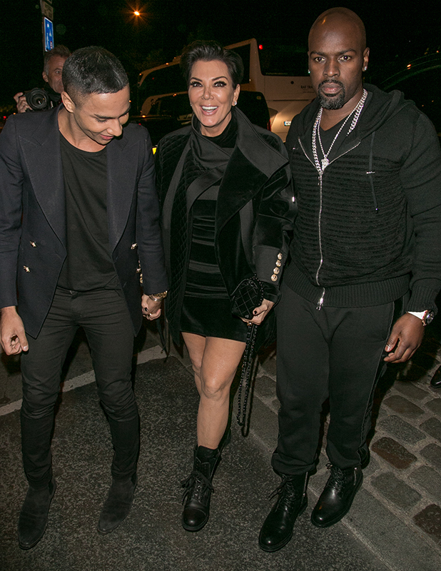 Designer Olivier Rousteing, Kris Jenner and Corey Gamble arrive to attend the Balmain aftershow party at 'Laperouse' restaurant on October 1, 2015 in Paris, France. (Photo by Marc Piasecki/GC Images)