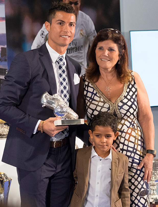 Cristiano Ronaldo attends a ceremony for becoming Real Madrid's all-time leading scorer at the Santiago Bernabeu stadium