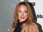 Lindsay Lohan gives us coat envy at Mark Hill Hair Launch in London!