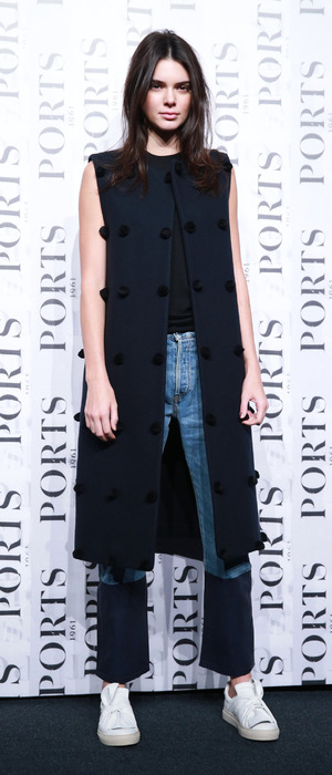 Kendall Jenner dressed in navy waistcoat at Shanghai Fashion Week, 14th October 2015