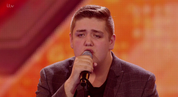 Tom Bleasby singing 'I Look To You' on the Boys 6 Chair Challenge edition of 'The X Factor'. 11 October 2015.