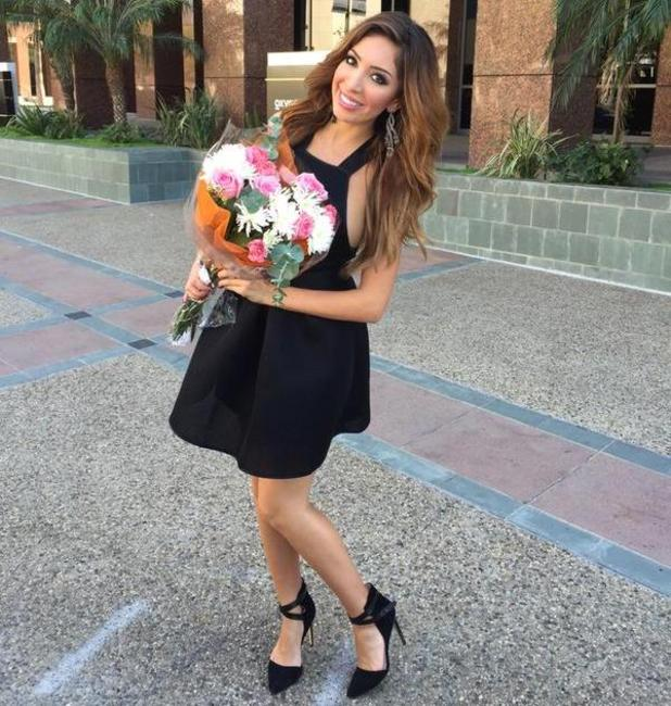 Farrah Abraham poses a bouquet of flowers after time in CBB house.