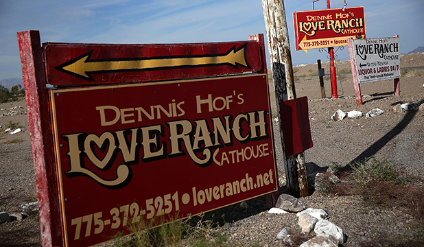 Signs for Dennis Hof's Love Ranch Las Vegas brothel are shown on October 14, 2015 in Crystal, Nevada. Former NBA player Lamar Odom was found unconscious during a visit at the brothel and has been hospitalized at Sunrise Hospital & Medical Center in Las Vegas. (Photo by Alex Wong/Getty Images)