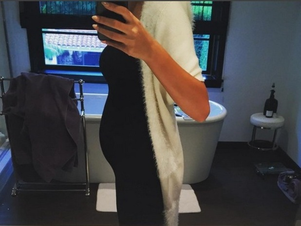Pregnant Chrissy Teigen shows off her baby bump for the first time, 19th October 2015