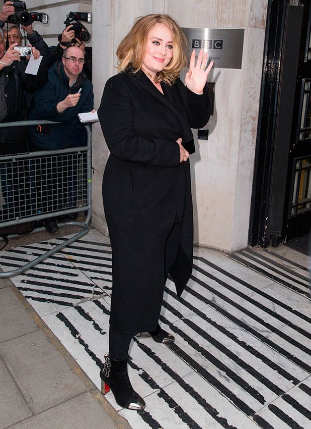 Adele pictured arriving at the Radio 2 studio to appear on the Chris Evans Breakfast Show to promote her new song, 'Hello' which is her first for 3 years