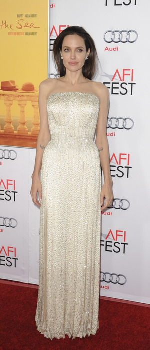 Angelina Jolie wears white beaded dress on the red carpet at the By The Sea Premiere in L.A, 6th November 2015