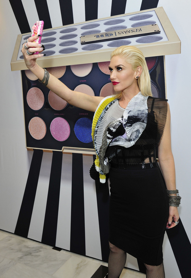 Gwen Stefani poses infront of giant Urban Decay Palette in Los Angeles 29th Octobe 2015