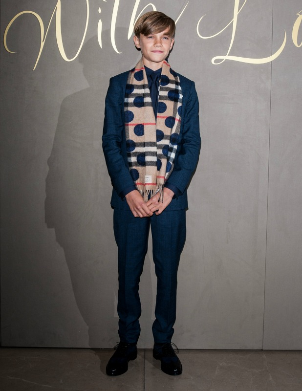 Romeo Beckham, Cruz Beckham and Victoria Beckham attend the Burberry Festive film premiere at 121 Regent Street on November 3, 2015 in London, England.