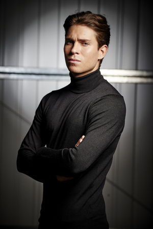 Joey Essex donned the iconic Milk Tray Man black polo neck and battled it out against celebrities in a star studded bootcamp, November 2015