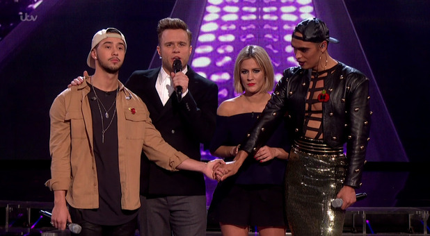 Mason Noise and Seann Miley Moore await the judges' verdict on the sing-off, on the results show of 'The X Factor'. 8 November 2015.