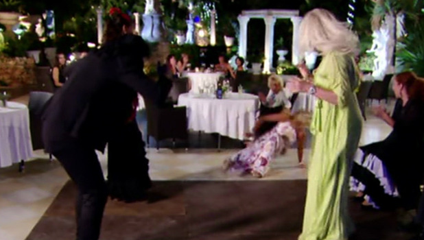 Debbie pushes over Carol Wright during a Flamenco class on 'The Only Way is Marbs'. 5 October 2015.