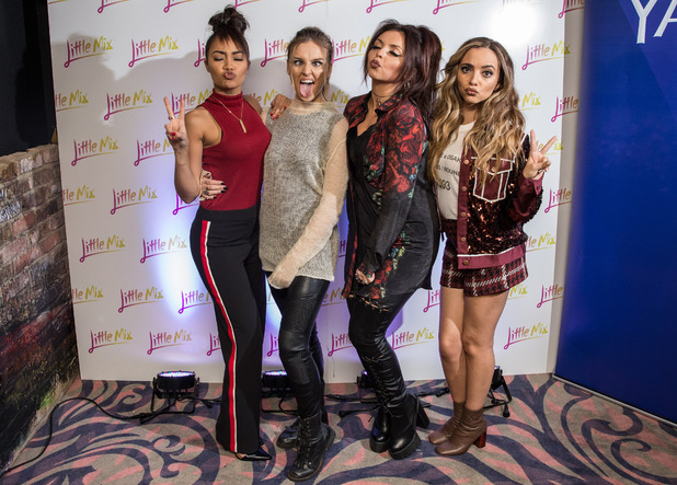 Little Mix pose up a storm at their Get Weird album signing in London, 10th November 2015