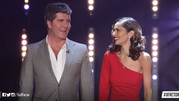 Cheryl Fernandez-Versini and Simon Cowell appear on The X Factor, 21 November 2015.