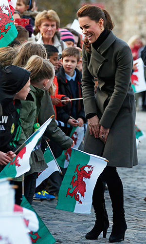 Catherine, Duchess of Cambridge laughs as she speaks with school children during a visit to Caernarfon on November 20, 2015 in Wales. (Photo by Phil Noble - WPA Pool/Getty Images)