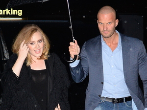 The internet is going crazy for Adele's hunky bodyguard