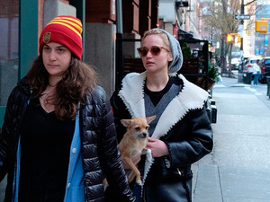 Jennifer Lawrence carries dog Pippi in chilly New York
