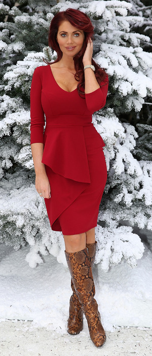 Amy Childs wears red dress at Ideal Home Show at Christmas in London, 25th November 2015