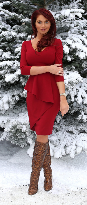 Amy Childs in red dress at Ideal Home Show at Christmas, London, 25th November 2015