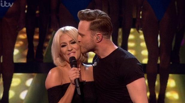 Olly Murs kisses Caroline Flack on 'The X Factor'. 22 November 2015.