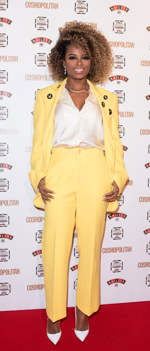 Fleur East wears yellow suit and attends the Cosmopolitan Ultimate Women of The Year Awards, 3rd December 2015