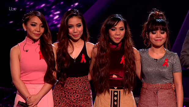 4th Impact listening to the judges' verdicts on the sing off, on the results for 'The X Factor'. Broadcast on ITV1 HD.
