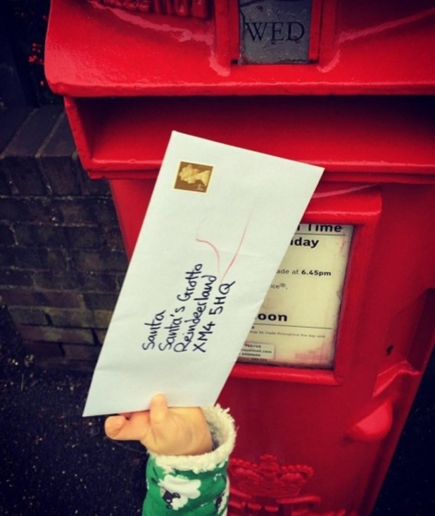 Tom Fletcher and son Buzz post letter to Santa 3 December