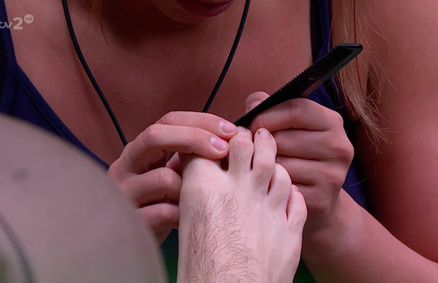 Ferne McCann is seen using a comb on George Shelley's feet on 'I'm A Celebrity... Get Me Out Of Here Now!'. Broadcast on ITV2 HD