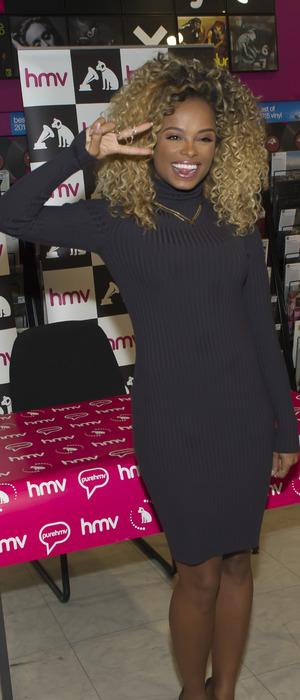 Fleur East at HMV Birmingham meeting fans and signing copies of her debut album