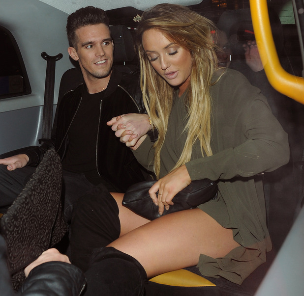 Charlotte Crosby and Gary Beadle holding hands in taxi 8 December