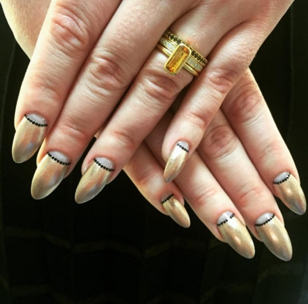 Adele wears gold, black and grey manicure, nails by Jenny Longworth, 7 December 2015