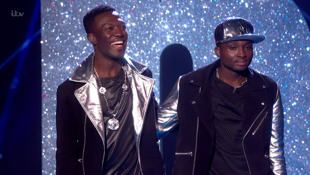 Reggie 'N' Bollie getting the judges' feedback after they had performed a medley of 'Spice Up Your Life' and 'Boom Boom Boom' on the final of 'The X Factor' - 12 December.