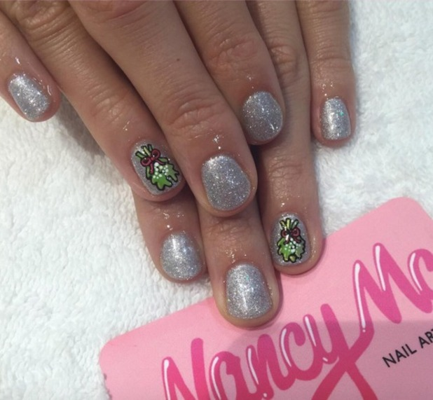 Pixie Lott reveals festive, mistletoe manicure, by Nancy McNails at Not Another Salon, London, 11 December 2015