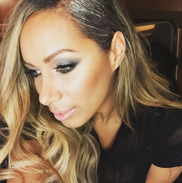 Leona Lewis shows off her hair, bedazzled with silver glitter, by Ben Cooke, for The X Factor performance with Ben Haenow, 12 December 2015