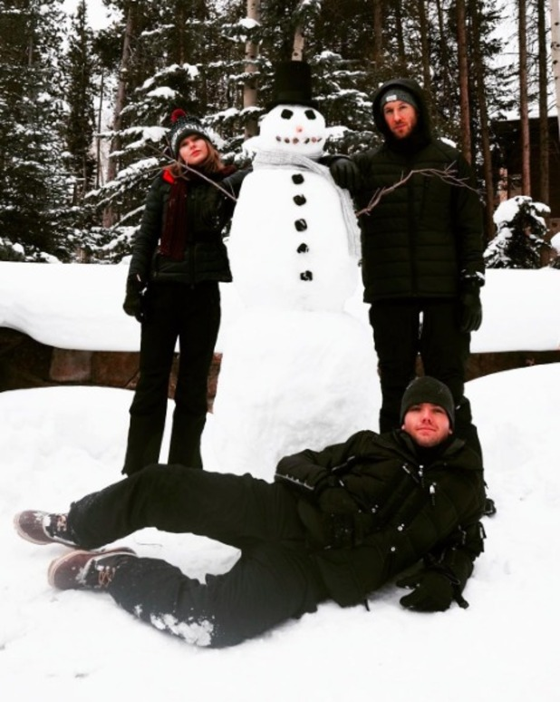 Calvin Harris and Taylor Swift get festive with snow! 23 December 2015.