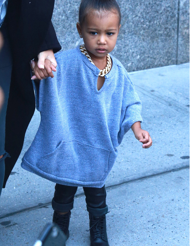 North West wears jersey and gold chain out and about in New York, 21st December 2015