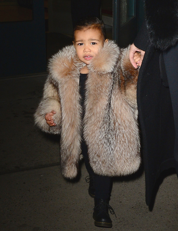 North West attends New York Fashion Week in faux fur coat, 21st December 2015