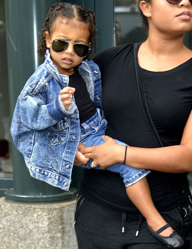 North West wears denim jacket and Ray Ban aviator sunglasses out and about in Los Angeles, 21st December 2015