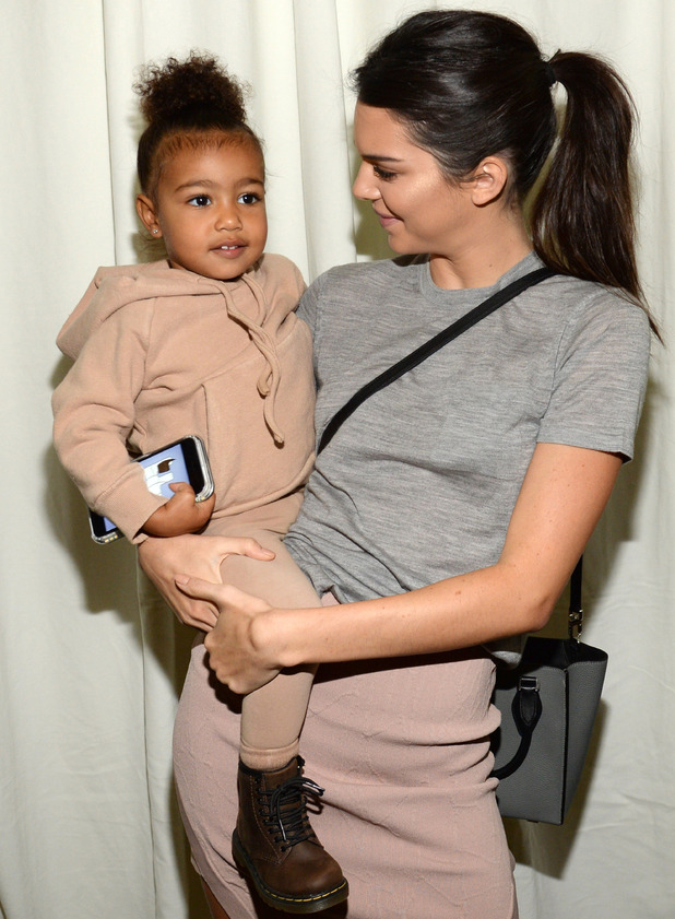North West wears tracksuit to Kanye's Yeezy Fall 2015 show in New York, 21st December 2015
