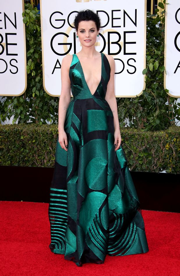 Thor actress Jaimie Alexander stunned in a super-low V, deep emerald Genny dress